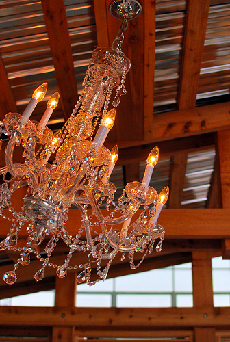 A donated chandelier swings in the breeze.