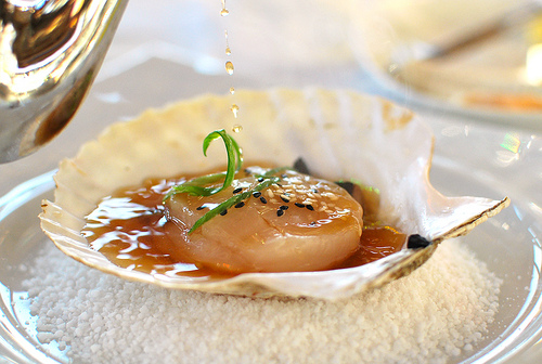 Freshly shucked Bayne Sound scallop with warm dashi broth. A good sustainable seafood choice, according to Ocean Wise-partner Seafood Watch.