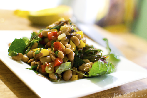 Black eyed peas with warm bacon vinaigrette, mango and wilted greens by Melody Fury