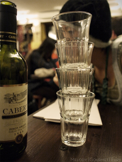 Wine glasses at Trattoria Al Gazzettino in Venezia Venice Italy by Melody Gourmet Fury