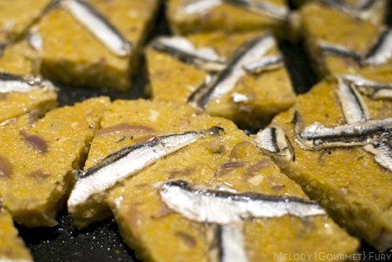 Anchovy polenta with shallots, pan frying to golden brown by Melody Gourmet Fury