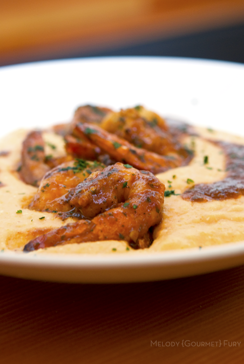 Barbecue shrimp on cheesy grits at Olivia Restaurant in Austin, Texas by Melody Gourmet Fury