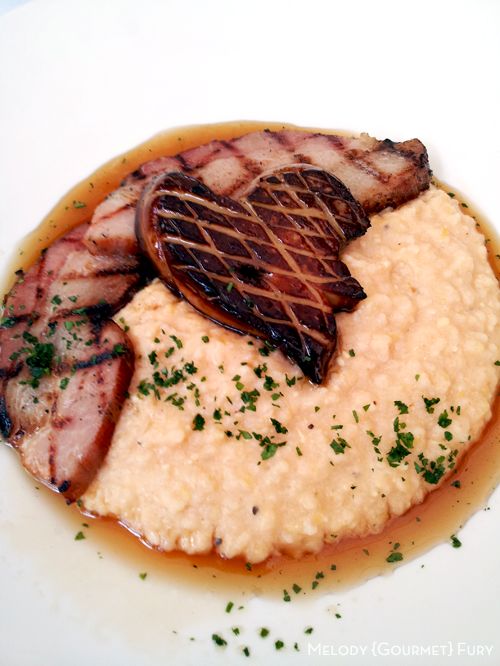 Foie gras and slab bacon on grits with maple syrup at Olivia Restaurant in Austin, Texas by Melody Gourmet Fury