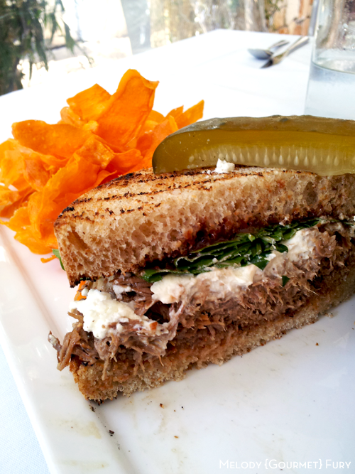 Beer braised lamb sandwich with chevre and arugula at Olivia Restaurant in Austin, Texas by Melody Gourmet Fury