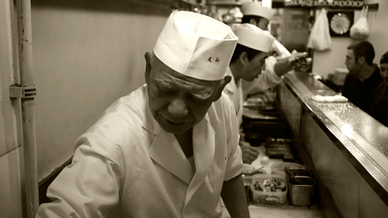 Sushi master at Daiwa Sushi Restaurant at Tsukiji Market in Tokyo Japan by Melody Fury Photography. Food, Drink, Restaurant Photographer and Writer in Vancouver BC and Austin TX