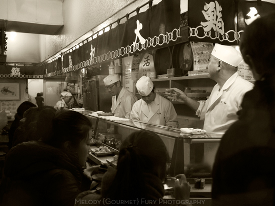 sushi counter  at Daiwa Sushi Restaurant at Tsukiji Market in Tokyo Japan by Melody Fury Photography. Food, Drink, Restaurant Photographer and Writer in Vancouver BC and Austin TX