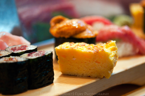 Tamago yaki egg at Daiwa Sushi Restaurant at Tsukiji Market in Tokyo Japan by Melody Fury Photography. Food, Drink, Restaurant Photographer and Writer in Vancouver BC and Austin TX