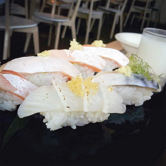 Ika nigiri at Komé Sushi Kitchen by Melody Fury Photography. Food, Drink, Restaurant Photographer and Writer in Vancouver BC and Austin TX