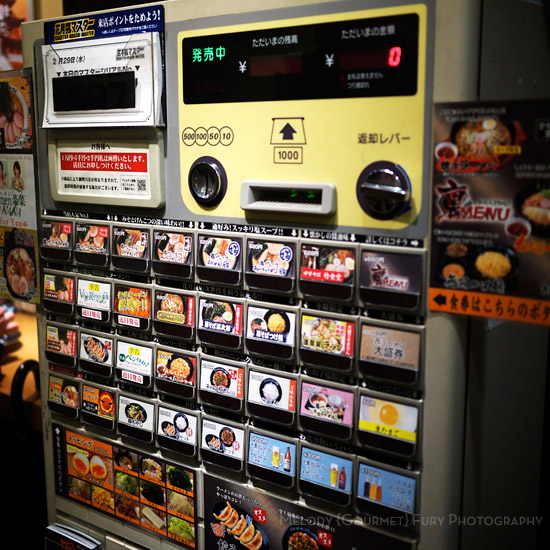 Ramen ordering machine  at Late Night Restaurants in Shinjuku Tokyo by Melody Fury Photography. Food, Drink, Restaurant Photographer and Writer in Vancouver BC and Austin TX