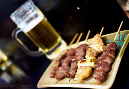 Yakitori and beer at Late Night Restaurants in Shinjuku Tokyo by Melody Fury Photography. Food, Drink, Restaurant Photographer and Writer in Vancouver BC and Austin TX