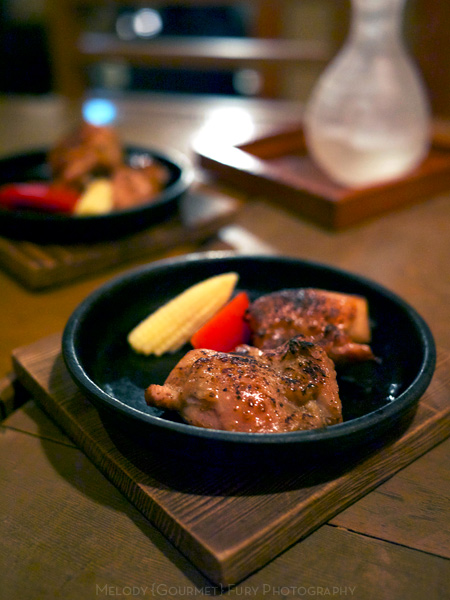 Grilled chicken at 豆腐料理 空ノ庭 tofu restaurant in Tokyo Japan by Melody Fury Photography. Food, Drink, Restaurant Photographer and Writer in Vancouver BC and Austin TX