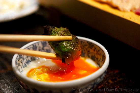 Tsukune in egg dip at Yakitori Akira Grilled Chicken Restaurant 焼鶏 あきら in Naka-meguro, Tokyo Japan